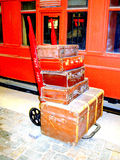 Railway porters trolley with cases Stock Images