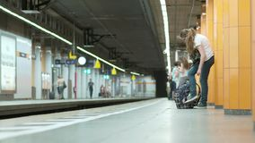 MUNICH BAYERN, GERMANY, EUROPE - JULY 02 . 2018 Railway public Transport. Railway public Transport platform railway, railroad. Commuters,Travelers, Tourists stock footage