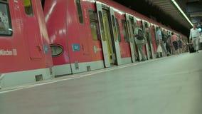 Munich Bayern, Germany, Europe - July 02 . 2018 Railway public Transport. Railway public Transport platform railway, railroad  Passengers getting off and stock video footage