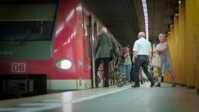 Munich Bayern, Germany, Europe - July 02 . 2018 Railway public Transport. Railway public Transport platform railway, railroad  Passengers getting off and stock footage