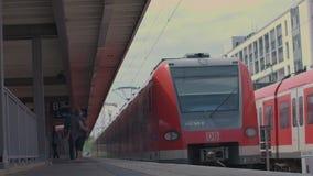 Munich Bayern, Germany, Europe - July 02 . 2018 Railway public Transport. Railway public Transport platform railway, railroad   S-bahn train arriving and stock footage