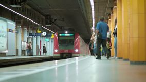 MUNICH BAYERN, GERMANY, EUROPE - JULY 02 . 2018 Railway public Transport. Railway public Transport platform railway, railroad   S-bahn train arriving on the stock footage