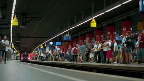 MUNICH BAYERN, GERMANY, EUROPE - JULY 02 . 2018 Railway public Transport. Railway public Transport platform railway, railroad   S-bahn train arriving on the stock video footage