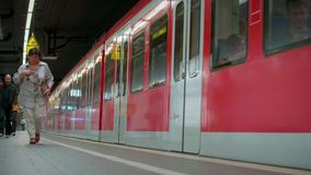 MUNICH BAYERN, GERMANY, EUROPE - JULY 02 . 2018 Railway public Transport. Railway public Transport platform railway, railroad S-bahn train departing from the stock footage