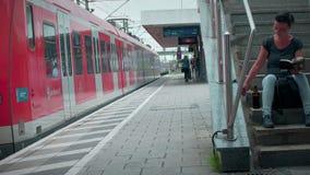 Munich Bayern, Germany, Europe - July 02 . 2018 Railway public Transport. Railway public Transport platform railway, railroad   S-bahn train departing at Munich stock video