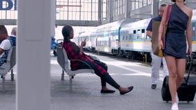 MUNICH, BAYERN GERMANY - JUN 01, 2018. Railway public Transport platform railway, railroad   Munich Train station, Commuters,Travelers, waiting to board stock footage
