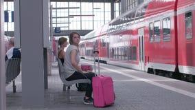 MUNICH, BAYERN GERMANY - JUN 01, 2018. Railway public Transport platform railway, railroad Regional express train arriving on the platform at Munich Train stock video footage