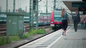 Munich Bayern, Germany, Europe - July 02 . 2018 Railway public Transport. Railway public Transport platform railway, railroad   S-bahn train arriving at Munich stock footage