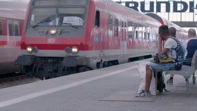 MUNICH, BAYERN GERMANY - JUN 01, 2018. Railway public Transport platform railway, railroad  train arriving on the platform at Munich Train station, Commuters stock footage