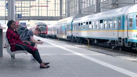 MUNICH, BAYERN GERMANY - JUN 01, 2018. Railway public Transport platform railway, railroad  train arriving on the platform at Munich Train station, Commuters stock video footage