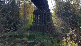 Railway/Railroad Bridge Over Flowing River in North America/Canada royalty free stock photos