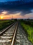 Railway. Railroad with orange sunset, Romania Stock Images
