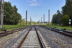 Railway or railroad tracks for train transportation under blue sky Royalty Free Stock Image