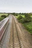 Railway or railroad tracks. Twin railway tracks curving to the left, UK standard gauge Stock Image