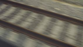 Railway rails shooting from a moving train stock video