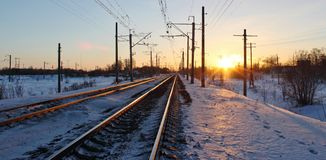 The railway in the rays of sunset Royalty Free Stock Photo