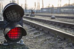 Railway red traffic light stop signal. Railway bright red traffic light stop caution warning signal urban landscape Royalty Free Stock Photos