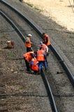 Railway repair. Workers in orange jacket make checkup royalty free stock images