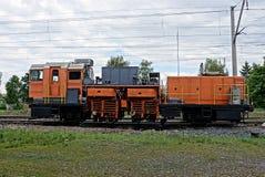 Railway repair train on orange rails Stock Images