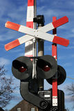 Railway and Road Crossing. Railway crossing sign with lights underneath. This is for a road traffic and to warn it of when a train is coming. The mechanics are stock photo