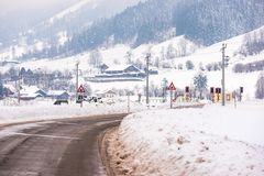 Railway-road crossing and the snow-covered fields in a scenic winter mountain landscape, Dachstein massif, Liezen District, Styria royalty free stock photos