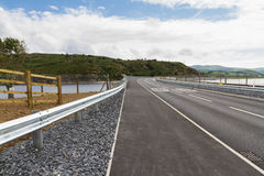 Railway and road over new river crossing, Pont Briwet bridge. Royalty Free Stock Photography
