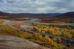 The railway runs along the river. Sob River. Polar Urals. Russia stock images