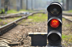 Railway semaphore. Traffic light shows red signal on railway. Red light Royalty Free Stock Photo