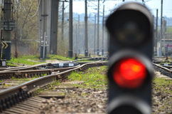 Railway semaphore. Traffic light shows red signal on railway. Red light Royalty Free Stock Image