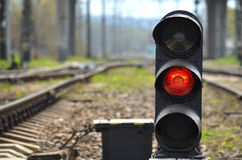 Railway semaphore. Traffic light shows red signal on railway. Red light Royalty Free Stock Photography