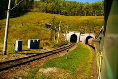 The railway in Siberia. Two railway tunnel with train, Russia, Siberia Stock Image