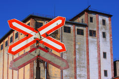 Railway sign. In focus - railway old sign. Out of focus - industrial building Royalty Free Stock Photos