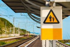Railway sign. `Do not leave children unattended` on the station and railroad going into the distance, Sochi, Russia Stock Photo