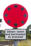 Railway Sign Obtain token and permission to proceed. Stock Images