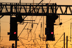 Railway signals at Red at Sunset Royalty Free Stock Photos