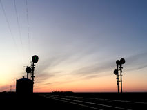 Railway Signals Silhouetted at Sunset Stock Photography