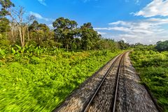 Railway from Singapore to Bangkok in the jungle of Malaysia. Railway from Singapore to Bangkok in the jungle of Malaysia royalty free stock image