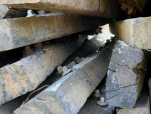 Railway sleepers - old - closeup. Pile of old railway sleepers with metal rail joiner attached Stock Photos