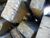 Railway sleepers - old. Pile of old railway sleepers with metal rail joiner attached Royalty Free Stock Image