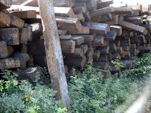 Railway sleepers - old -. Pile of old railway sleepers with metal rail joiner attached Stock Photo