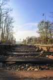Railway sleepers on the tracks. In the background signals and traffic lights with blue sky Stock Photo