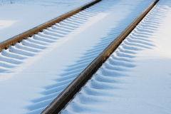 Railway after snowfall in winter with sleepers covered with snow. Stock Photos