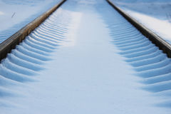 Railway after snowfall in winter with sleepers covered with snow. Stock Images