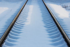 Railway after snowfall in winter with sleepers covered with snow. Royalty Free Stock Photo