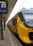 Railway station. Dutch railway station with yellow train Stock Image