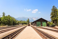 Railway station against beautiful blue sky and far mountains Stock Images