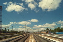 Railway station of Balashov. Rails under the summer blue cloudy sky, stretching away to the horizon Royalty Free Stock Photos