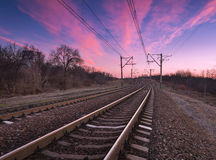 Railway station with beautiful sky at colorful sunset Stock Photos