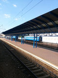 The railway station with blue cars Stock Image