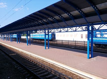 The railway station with blue cars Royalty Free Stock Photos